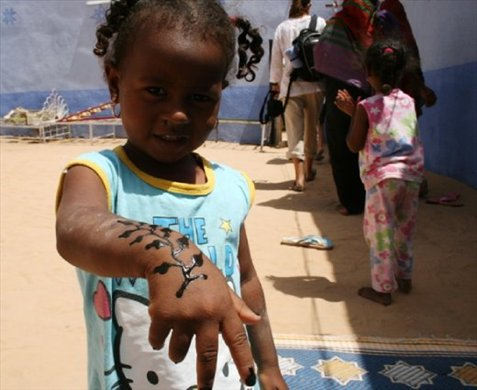 One of the kids showing off her henna tattoo before we left