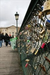 Pont des Arts pedestrian bridge - covered in locks for all those lovers out there. Have to be removed every 6 months to prevent the bridge collapsing under the weight of love: by drmitch, Views[640]