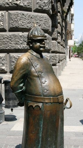 Statue of a local bobby, who has obviously eaten too many donuts