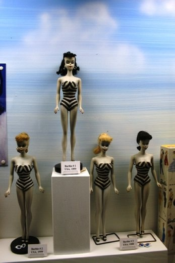 Original Barbie Dolls in the museum - their skin would be bleached white by the light
