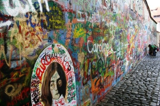 The Lennon Wall - filled with John Lennon-inspired graffiti and pieces of lyrics from Beatles songs. In 1988, the wall was a source of irritation for the communist regime of Gustáv Husák. Young Czechs would write grievances on the wall and in a report of the time this led to a clash between hundreds of students and security police on the nearby Charles Bridge.