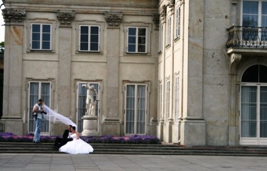 Wedding photos being shot at The Łazienki Palace (Baths Palace); also called the Palace on the Water