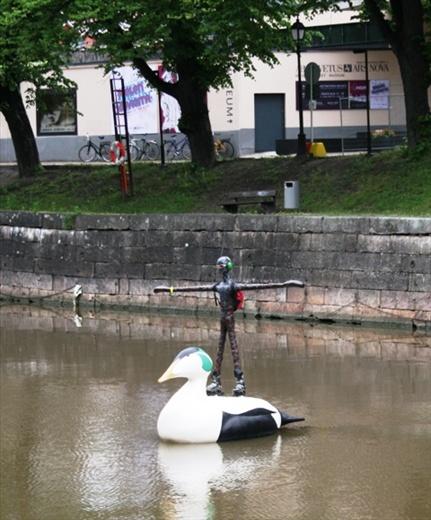 Strange rollerblade-wearing swan-balancing statues