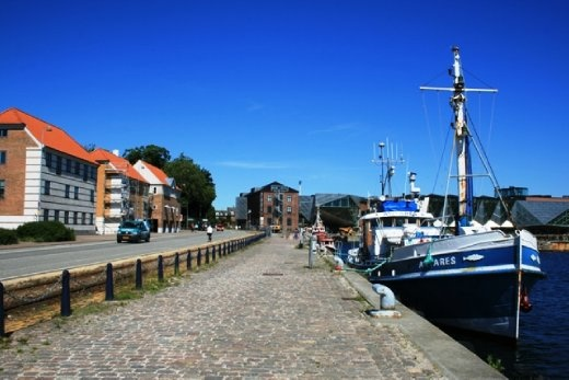 Walking along the waterfront of the town