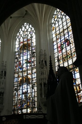 Inside Kapellekerk checking out the beautiful stained glass windows