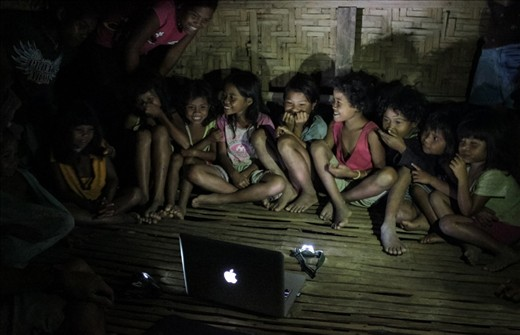 A Matigsalug tribe kids enjoying the show prepared by my friend. Seems like it's their first time watching a movie. There's no electricity and phone signal in this area.