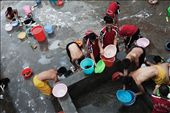 China. Henan province. Dengfeng city. Shaolin Tagou Martial Arts School. Young students washing their tracksuits in the courtyard of the school.: by edoardolucci, Views[661]
