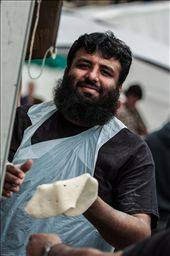 # Kneading  Huddersfield has a hugely diverse population and Food & Drink Festival reflects this.  Here a Pakistani stall holder can't help showing off for the camera as he hand prepares his naan breads.: by edrollasonphoto, Views[122]
