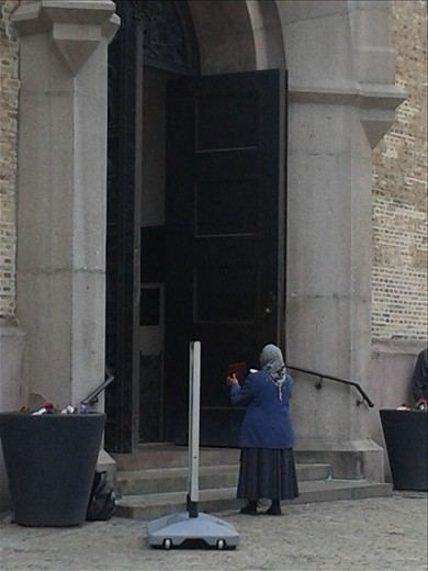 A women begging outside a church, Oslo