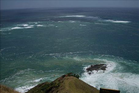 cape reinga, where the pacific ocean meets the tasman sea