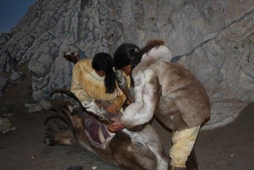 Some Canadian Aboriginies preparing elk. Delicious. May not be real.