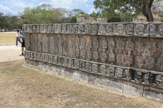 Wall covered in skull carvings