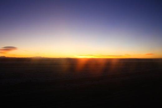 Sunrise over salt flats.