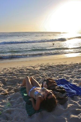 Sunset at Ipanema Beach at Rio, watching a surf contest
