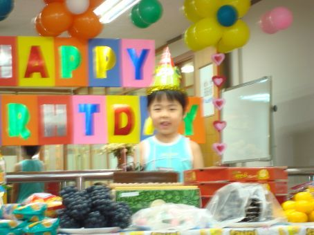 Birthday Boy Eric.  Who is seriously one of THE cutest kids.  Sorry that it's blurry, but it's the only pic I got of him smiling!  haha