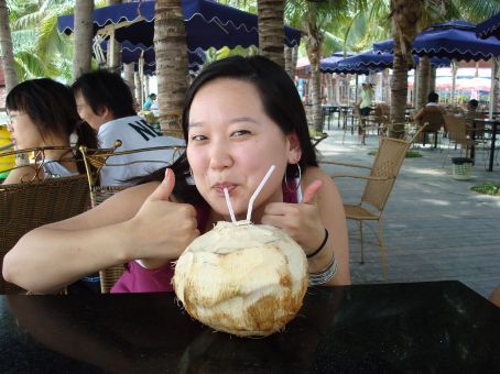 There's nothing like a coconut on the beach while a man in the background keeps asking if you want your ears cleaned by huge metal prongs.