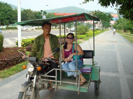 Me in the motorbike.  Priscilla and I sat on the seat while Mark sat behind the driver.  The driver ate betel nuts and his mouth and teeth were all red.  It made him look even more angry than he already was of me taking a picture in his cart.