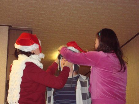 Yoomi and Cassie putting all of Luc's hats on him at one time.