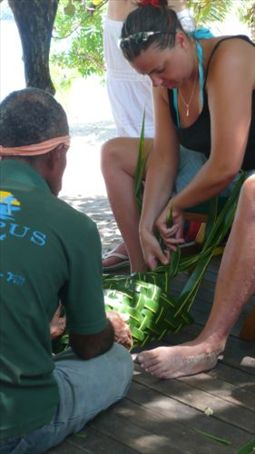Em making a Palm leaf basket