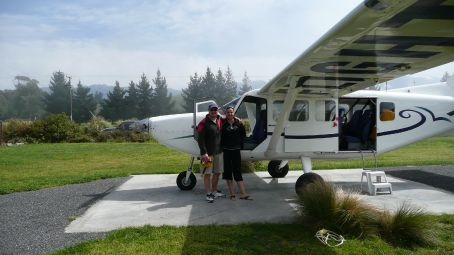 Us in front of the smallest plane Em' has been in.