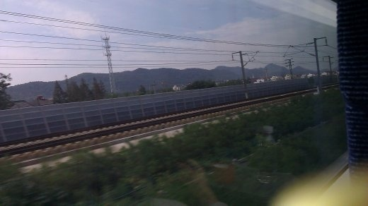 The parallel track and beginning of the mountains.