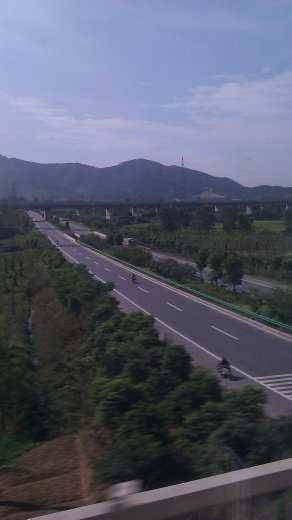 The highway paralleling the railway and the mountains