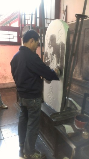 The process of creating the stone rubbings - applying the ink
