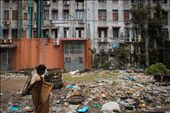 A woman adjusts her longyi as she walks the squalid streets of Yangon.: by emiliehayward, Views[984]
