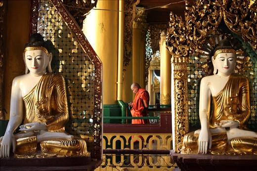 Amidst tradition at Shwedagon Paya, a buddhist monk embraces technology.