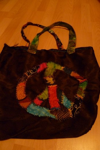 Another of my creations. Sewing is fascinating too when you think that you can make anything you want, the way you want it. That bag turned out to be quite useful and it gets some comments from people everytime it goes out!!!! hihihi