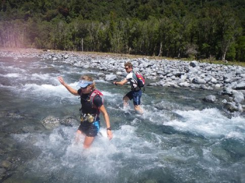 Scott and Emma on one of nearly 20 river crossings during the 33 km mountain run