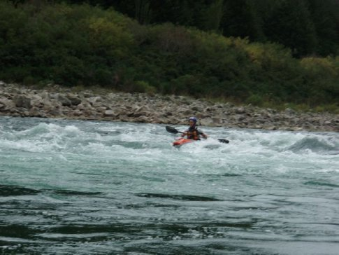 Scott passing through a wave train on the Buller River