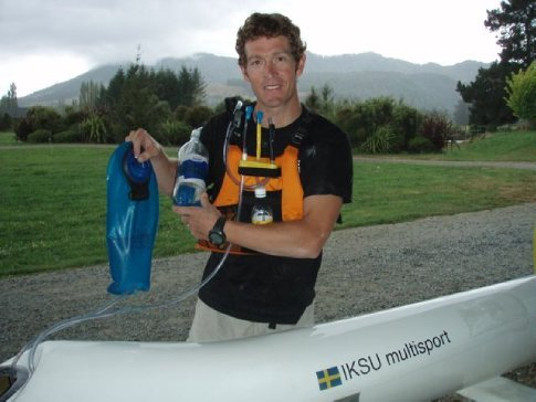 Scott demonstrating his kayak drinking system for the race. An old 1.5 L Coke bottle has been transformed into a milkshake delivery system, complete with extra wide drink hose (so the thick shake doesn't get stuck). A small 350 mL Coke bottle will deliver some caffeinne and quick sugar (in the form of Coke) at the 3 hr mark when he's starting to slow down. And finally the 3 L water bladder will be stored inside the kayak, delivering sportsdrink that comes up through an extra long hose through a hole in the kayak.