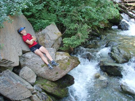 Taking a nap by a stream on our long and brutal climb over Gray's Pass