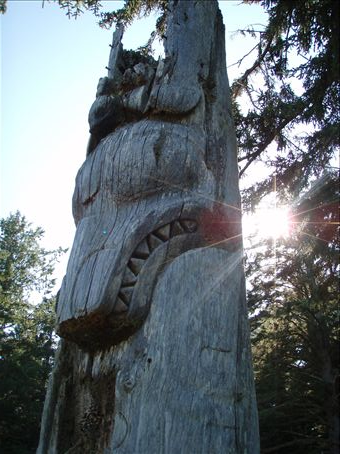 150 years old totempole with a wolf