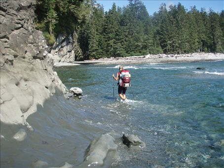 Wading over a surge channel (created from the tide going in and out of an already existing stream)