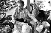 MOHINGA: One of the best ways to understand others history is through its food. This lady is preparing Myanmar's traditional rice noodle snack called mohinga for her customer. A great snack to start the day.: by emmir, Views[637]