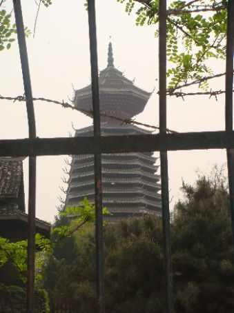 Cool pagoda, seen through fence