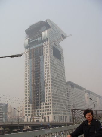 Unfinished side of monster hotel building; to right are its babies
