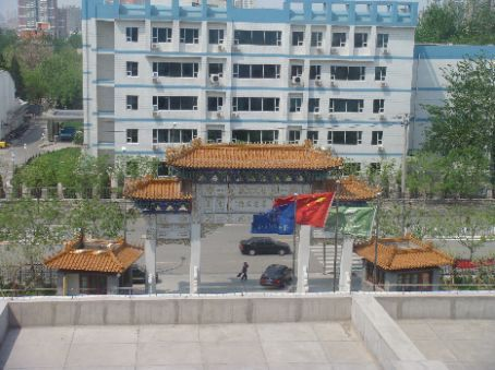 View from hospital of front gate to hospital; I walked by this every day to get to the Tourist Restaurant