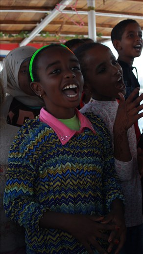 Nubian kids singing on their way to school on sailing boat ,This a traditional habit there.