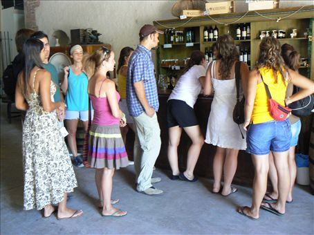 Grace queuing up for her holy wine - Mendoza winetasting