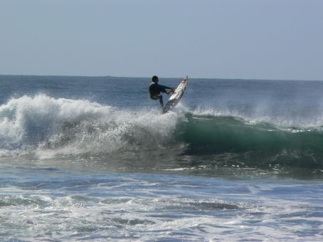 Grace catching a wave
