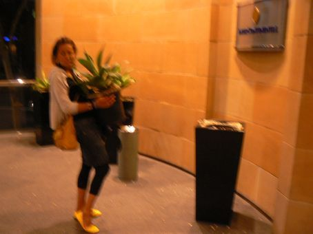 MT getting carried away stealing a plant from our 5-star hotel...her excuse