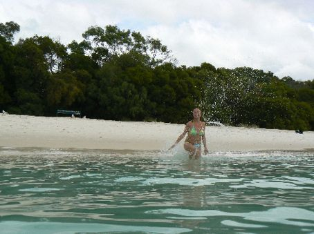 Run Grace - in slow motion and splash a bit bit of water like they do in the movies