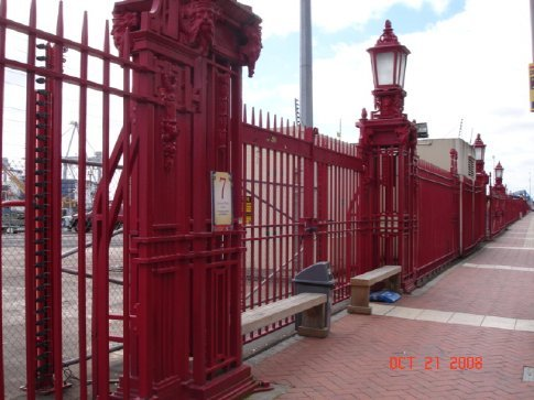 An old red fence around the port.