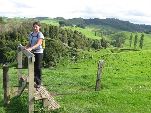 Erin demonstrating the NZ farmer's engineering... fields of sheep make up much of the hike, so to keep the sheep in their fences, hikers have to take the steps over the top.