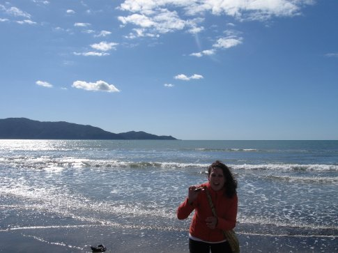 Holding up a giant clam on the beach in Paraparaumu.