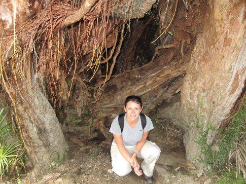 Erin in a tree trunk.