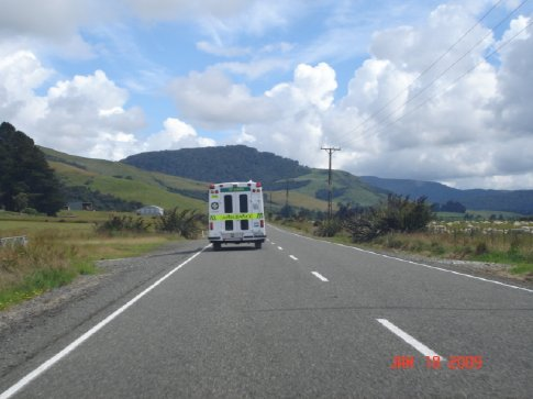 Now I'm following the slow-moving ambulance... and, yes, that is a field of sheep.